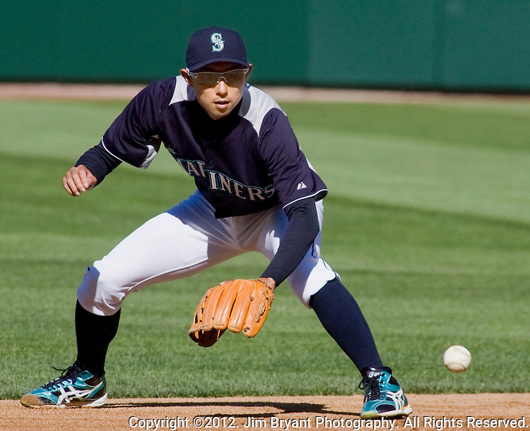 Seattle Mariners second baseman  Munenori Kawasaki, of Japan, fields hits before the Mariner's  opening home game of the season with the Oakland Athletics at SAFECO Field in Seattle April 13, 2012. . © 2012. Jim Bryant Photo. All Rights Reserved.