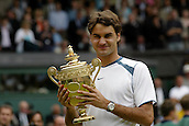 3 July 2005: Swiss player Roger Federer celebrates winning the title during with the trophy after his finals singles match against Roddick at the All England Lawn Tennis Championships, Wimbledon, London. Federer won the match 6-2, 7-6 (7-2), 6-4 to take his third singles title. Photo: Glyn Kirk/Actionplus..050703 man men male final winner celebrate celebration celebrating joy win cup