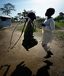 Girls skipping rope during a school recess in the Gendrassa refugee camp in South Sudan's Upper Nile State. More than 110,000 refugees were living in four camps in Maban County in October 2012, but officials expected more would arrive once the rainy season ended and people could cross rivers that block the routes from Sudan's Blue Nile area, where Sudanese military has been bombing civilian populations as part of its response to a local insurgency. Conditions in the camps are often grim, with outbreaks of diseases such as Hepatitis E.