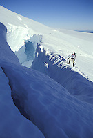 Climber on edge of crevasse on Blue Glacier, Mount Olympus, Olympic National Park, Washington