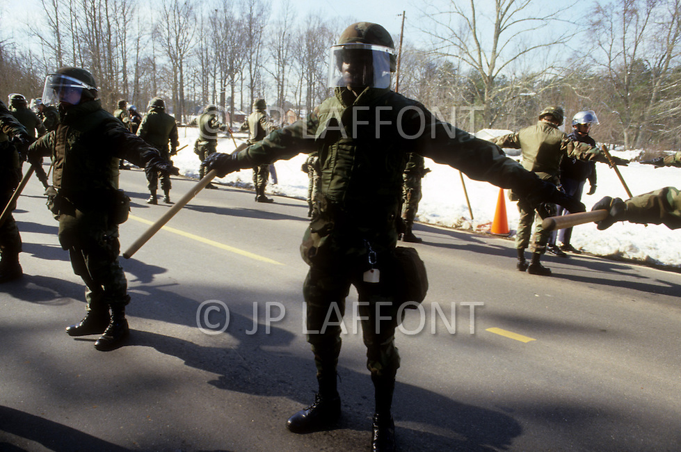 Georgia, Forsyth County, Cumming, 14th, January, 1987. 20,000 people on protest march against racism. The Ku Klux Klan also appeared to oppose demonstration. As a precaution, lot's of police presence.