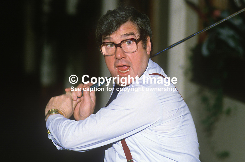 Frank Carson, born Belfast, N Ireland, comedian, comic, actor, swinging a golf club at City Hall, Belfast, N Ireland, to promote a charity golf event. 19860103FC4..Copyright Image from Victor Patterson, 54 Dorchester Park, Belfast, United Kingdom, UK...For my Terms and Conditions of Use go to http://www.victorpatterson.com/Victor_Patterson/Terms_%26_Conditions.html