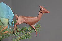 OrigamiUSA holiday tree at the American Museum of Natural History 2014. Pterosaurs designed by Fumiake Kawahata, Fernando Gilgado Gomez, and other designers. Origami deer designed by Stephen Weiss folded by Robert Taylor.