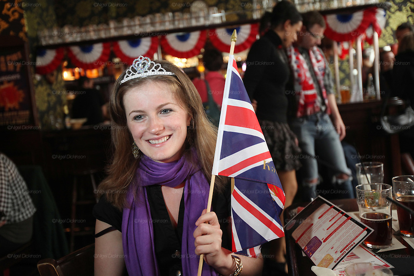 Emily, an Easy Jet Air Hostess dresses up in Tiara with British Flag just after the Royal Wedding celbrations come to an end..Many nationalities, especially English, Australians and French, coming together at midday in the English traditional style 'Frog and Rosbif' Pub in the centre of Paris, to watch the Royal Wedding of Prince William and Catherine Middleton in London. At 119 rue Saint Denis, Paris, France