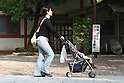 May 5, 2010 - Tokyo, Japan - A mother pushes a baby-carriage in a park in Tokyo, Japan, on May 5, 2010. The number of children aged under 15 in Japan has hit a record low of under 17 million, according to a government report released Tuesday. The child population is estimated to have dropped 190,000 from a year earlier to 16.94 million, marking the 29th consecutive annual decline. The report also showed that children's share of the nation's entire population stood at 13.3%, compared with 23% for a population of people aged over 65.