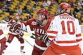 Pier-Olivier Michaud (Harvard - 39), Corey Trivino (BU - 10) - The Harvard University Crimson defeated the Boston University Terriers 5-4 in the 2011 Beanpot consolation game on Monday, February 14, 2011, at TD Garden in Boston, Massachusetts.