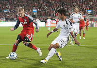 13 April 2011: Toronto FC midfielder Gianluca Zavarise #28 and Los Angeles Galaxy defender A.J. DeLaGarza #20 in action during an MLS game between Los Angeles Galaxy and the Toronto FC at BMO Field in Toronto, Ontario Canada..The game ended in a 0-0 draw.
