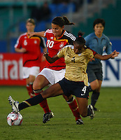 Crystal Dunn (USA) competes for the ball with Dzsenifer Marozsan (GER)..FIFA U17 Women's World Cup, Semi Final, Germany v USA, QEII Stadium, Christchurch, New Zealand, Thursday 13 November 2008. Photo: Renee McKay/PHOTOSPORT