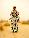 """Sale Ag Moussa, 20-years-old recently join the Tuareg rebels of the """"Democratic Alliance for Change"""". Northern Mali, July 2008."""