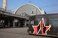 U-Bahn or underground train in Alexanderplatz, with the Bahnhof or Berlin Alexanderplatz Station behind, Berlin, Germany. Picture by Manuel Cohen