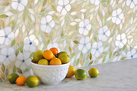 Jacqueline, a jewel glass waterjet mosaic shown in Absolute white, Chalcedony, Peridot, and Quartz/Agate, is part of the Silk Road Collection by Sara Baldwin for New Ravenna Mosaics.