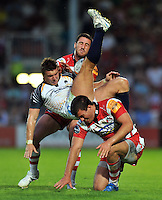 Andy Short is taken out in the air. J.P. Morgan Premiership Rugby 7s match, between Gloucester Rugby and Worcester Warriors on July 27, 2012 at Kingsholm Stadium in Gloucester, England. Photo by: Patrick Khachfe / Onside Images