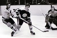 Boston Bruins star Bobby Orr..against Bert Marshall and goalie Gilles Meloche/ (1972/photo/Ron Riesterer)