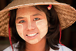 Portrait of a girl with the traditional face make-up and sun screen thanakha, Myanmar