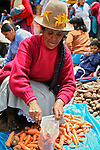 Americas, South America, Peru, Pisac. Carrot vendor at Pisac Market.
