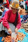 Americas, South America, Peru, Pisac. Carrot vendor at Pisac Market.
