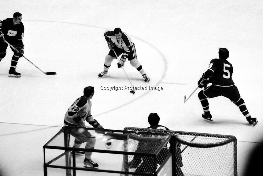 California Seals vs Vancouver Canucks 1971...Bill Hickey attacks goal with Gary Jarrett. Canucks #5 John Schella, and goalie George Cardner (photo/Ron Riesterer)