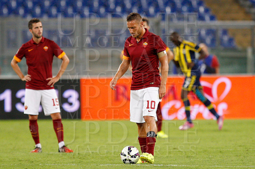 Calcio, amichevole Roma vs Fenerbahce. Roma, stadio Olimpico, 19 agosto 2014.<br /> Roma midfielder Miralem Pjanic, of Bosnia, left, and forward Francesco Totti react during the friendly match between AS Roma and Fenerbahce at Rome's Olympic stadium, 19 August 2014.<br /> UPDATE IMAGES PRESS/Riccardo De Luca