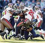 Seattle Seahawks  defensive unit stops Tampa Bay Buccaneers  running back Michael James (25) in the second quarter at CenturyLink Field in Seattle, Washington on  November 3, 2013.  The Seahawks beat the Buccaneers 27-24 in overtime. ©2013. Jim Bryant. All Rights Reserved.
