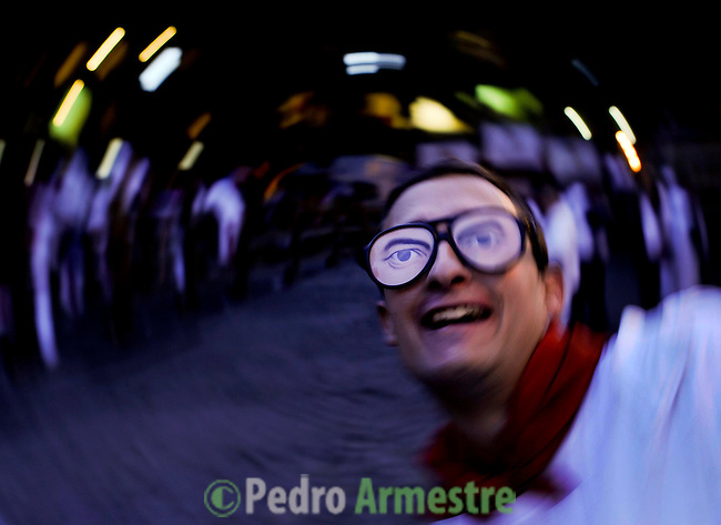 A man smiles before the seventh Running after San Ferm&iacute;n Festival bull run, on July 13, 2012, in Pamplona, northern Spain. The festival is a symbol of Spanish culture that attracts thousands of tourists to watch the bull runs despite heavy condemnation from animal rights groups. (c) Pedro ARMESTRE