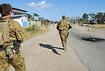 Australian Special Forces chase after rival gangs as they clash at the bridge in the Comora area of Dili, a hot point for clashes between rival gangs, the ( Lorosae) and the Westerners (Loromonu). Much of the violence is tat for tat revenge for the lotting and burning of homes. 05/06/06 East Timor