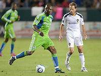 CARSON, CA – NOVEMBER 7:  Seattle Sounders forward Blaise Nkufo (9) and LA Galaxy defender Eddie Lewis (6) during a soccer match at the Home Depot Center, November 7, 2010 in Carson, California. Final score LA Galaxy 2, Seattle Sounders 1.