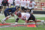 College Park, MD - April 1, 2017: Maryland Terrapins Austin Henningsen (18) tries to get the groundball during game between Michigan and Maryland at  Capital One Field at Maryland Stadium in College Park, MD.  (Photo by Elliott Brown/Media Images International)