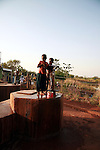 Children fetching water from the infected pond using a handpump. Gburumani, Northern Region, Ghana.