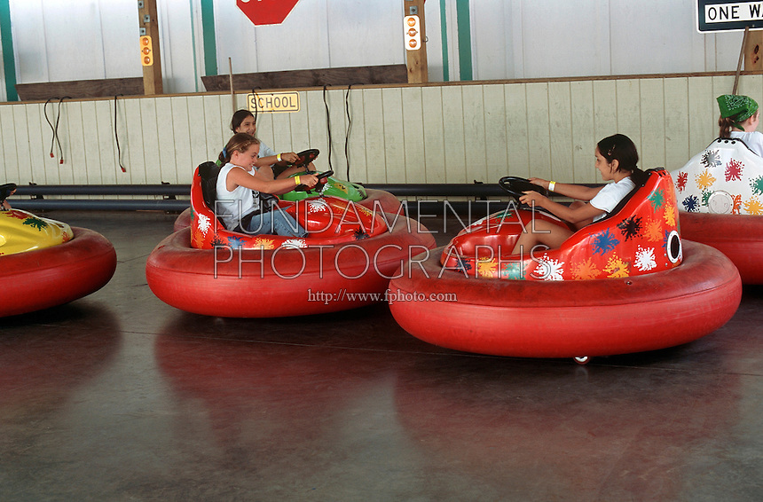AMUSEMENT PARK RIDES<br /> Bumper Cars<br /> When bumper cars collide, the drivers feel a change in their motion and become aware of their inertia. Though the cars themselves may stop or change direction, the drivers continue in the direction they were moving before the collision.