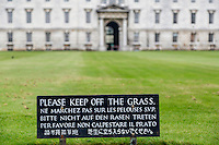 UK, England, Cambridge.  Multilingual Sign in English, French, German, Italian, Chinese, and Japanese:  Please Keep off the Grass.