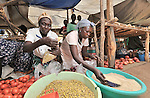 Hellesa Gune (left) and Tamara Kako sell food in the market in Yei, Southern Sudan, supported by a microfinance program run by the United Methodist Women in Yei.