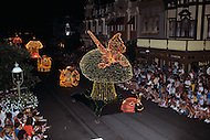 Orlando, Florida - Circa 1986. Disney World caterpillars, ladybugs, snails and butterflies  greet audience at the Main Street Electrical Parade. The Main Street Electrical Parade was created by Bob Jani and Ron Miziker, and first appeared at Disney World on June 11, 1977. Disney World is a world-renowned entertainment complex that opened October 1, 1971 in Lake Buena Vista, FL. Now known as the Walt Disney World Resort, the property covers 25,000 acres and has an annual attendance of 52.5million people.