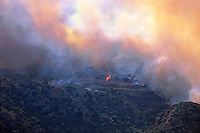870000405 the topanga wild fire burns along a ridgeline right next to hillside homes in chatsworth in la county california