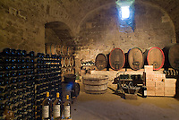 Wine cellar inside a castle in Cazeneuve, Aquitane, France.