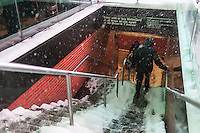 "Visitors maneuver icy subway steps in Times Square in New York during a snow storm on Tuesday evening, January 21, 2014. The official snowfall in Central Park was 11 inches (28 centimeters) which was a record for the day.  Brutal ""Polar Express"" temperatures in the single digits accompanied the snow with the arctic temperatures expected to last several days.  (© Richard B. Levine)"