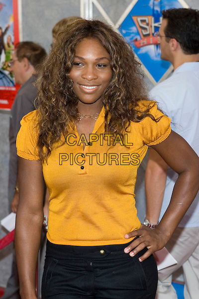 SERENA WILLIAMS.Walt Disney Pictures' World Premiere of 'Sky High' held at the El Capitan Theatre, Hollywood, California.  .July 24th, 2005.Photo Credit: Zach Lipp/AdMedia.half length yellow shirt hand on hip.www.capitalpictures.com.sales@capitalpictures.com.© Capital Pictures.
