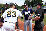03 June 2016: Nova Southeastern head coach Greg Brown (44) shakes hands with Millersville head coach Jon Shehan (23) as home plate umpire Brad Newton (right) watches. The Nova Southeastern University Sharks played the Millersville University Marauders in Game 13 of the 2016 NCAA Division II College World Series  at Coleman Field at the USA Baseball National Training Complex in Cary, North Carolina. Nova Southeastern won the first game of the best of three Championship Series 2-1.