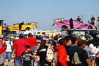 Oct 16, 2015; Ennis, TX, USA; Crew members unload the cars of NHRA funny car driver Alexis DeJoria (right) and teammate Del Worsham in the pits during qualifying for the Fall Nationals at the Texas Motorplex. Mandatory Credit: Mark J. Rebilas-USA TODAY Sports