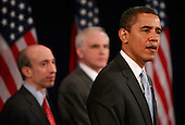 Chicago, IL - December 18, 2008 -- United States President-elect Barack Obama introduces Gary Gensler (L), to head the Commodities Futures Trading Commission (CFTC), and named Daniel Tarullo (C) to the Federal Reserve Board of Governors during a press conference at the Drake Hotel December 18, 2008 in Chicago, Illinois. Obama also named Mary Schapiro, CEO of the Financial Industry Regulatory Authority (FINRA), as his choice to head the U.S. Securities and Exchange Commission (SEC) at the press conference. .Credit: Scott Olson - Pool via CNP