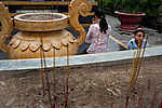 "A mother and daughter pray to a statue of ""Phat Thich Ca Mau Ni"" or ""Sakyamuni Buddha"" at the Giac Lam Pagoda in Tan Binh District in Ho Chi Minh City, Vietnam. Photo taken Tuesday, May 4, 2010....Kevin German / LUCEO"