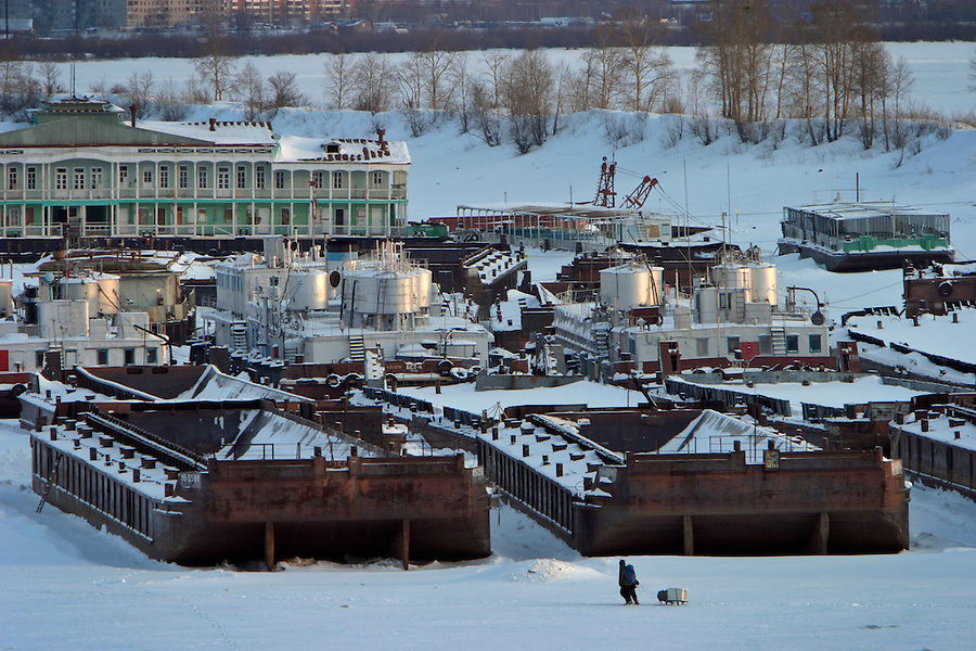 Khabarovsk, Russia, 01/03/2004.&amp;#xD;Two men walk across the frozen Amur river toward the city port.&amp;#xD;<br />