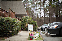 The scene at Finley Forest where Deah Barakat, 23, a UNC student; his wife, Yusor Abu-Salha, 21; and her sister, Razan Abu-Salha, were shot to death in Chapel Hill, North Carolina on Thursday, February 12, 2015. Craig Hicks, 46, has been charged with three counts of first-degree. (Justin Cook)