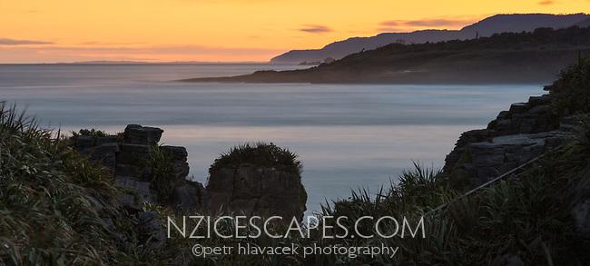 Photo of sunrise at Pancake Rocks, limestone formations on wild coast in Punakaiki, Paparoa National Park, Buller Region, West Coast, New Zealand, NZ