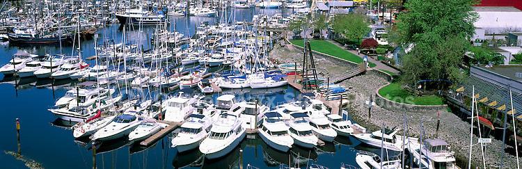 Motorboats, Yachts, and Sailboats docked at Granville Island Marina in False Creek, Vancouver, BC, British Columbia, Canada - Panoramic View