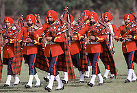 Ceremonial military bank wearing tartan and playing traditional bagpipes in Delhi, India
