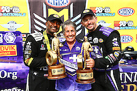 Jul 10, 2016; Joliet, IL, USA; NHRA top fuel driver Antron Brown (left) and funny car driver Jack Beckman (right) celebrate with sponsor Terry Chandler after winning the Route 66 Nationals at Route 66 Raceway. Mandatory Credit: Mark J. Rebilas-USA TODAY Sports