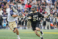 Annapolis, MD - April 15, 2017: Army Black Knights Gunnar Miller (24) holds off the Navy Midshipmen defender during game between Army vs Navy at  Navy-Marine Corps Memorial Stadium in Annapolis, MD.   (Photo by Elliott Brown/Media Images International)