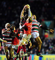 Brendon O'Connor and Peter Betham of Leicester Tigers compete with Jackson Wray of Saracens for the ball in the air. Aviva Premiership match, between Leicester Tigers and Saracens on January 1, 2017 at Welford Road in Leicester, England. Photo by: Patrick Khachfe / JMP