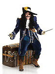 Laughing pirate with a sword and a hook protecting his treasure chest full of gold. Isolated on white background