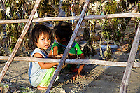 Kids play along drying seaweeds in Panagatan, Caluya. Seaweed farming is the main business here but it took a huge hit after Typhoon Yolanda (Haiyan) washed away most of the crops.
